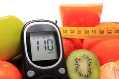 Glucometer, fruits, tape measure, juice and dumbbells Royalty Free Stock Photography