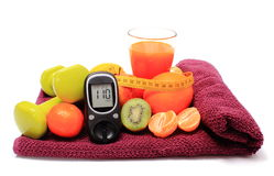 Glucometer, fruits, tape measure, juice and dumbbells Royalty Free Stock Image