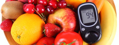 Glucometer with fruits and vegetables, healthy nutrition, diabetes Royalty Free Stock Photography