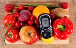 Glucometer with fruits and vegetables, healthy nutrition, diabetes Royalty Free Stock Photo