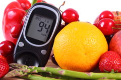 Glucometer with fruits and vegetables, healthy nutrition, diabetes Royalty Free Stock Images