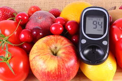 Glucometer with fruits and vegetables, healthy nutrition, diabetes Stock Photography