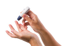 Glucometer in  hands Royalty Free Stock Photo