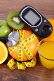 Glucometer, stethoscope, fruits, juice and centimeter, diabetes lifestyles and nutrition Royalty Free Stock Photos