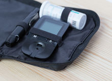 Glucometer and test strip lies in  bag case Stock Image