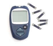 Glucometer and the test strips Royalty Free Stock Image