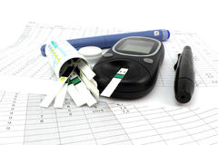 Glucometer test strips and insulin Royalty Free Stock Images
