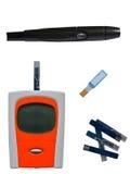 Glucometer, un dispositivo para que puntura y tiras de prueba midan blo fotografía de archivo libre de regalías