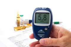 Glucometer in woman's  hand Royalty Free Stock Images