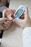 Glucose level blood test. From finger Stock Photo