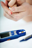 Glucose Level Blood Test. Closeup of the Diabetic Doing a Glucose Level Finger Blood Test Royalty Free Stock Images
