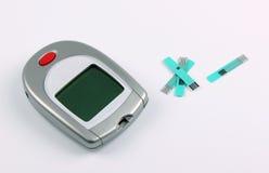 Glucose meter for blood sugar. Glucose meter to test blood sugar on white Stock Image