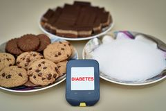 Glucose meter, cookies and sugar stock images