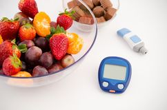 Glucose meter device with accessories. Royalty Free Stock Photo