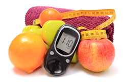 Glucose meter, fresh fruits, tape measure, accessories for fitness Stock Photo