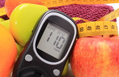 Glucose meter, fruits, tape measure, accessories for fitness Royalty Free Stock Images