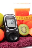 Glucose meter, fruits, tape measure and glass of juice Stock Images