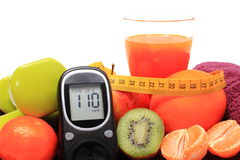 Glucose meter, fruits, tape measure, juice and dumbbells Royalty Free Stock Image