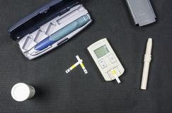 Glucose meter and Insulin pen. Royalty Free Stock Images