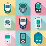 Glucose meter sugar test icons set, flat style. Glucose meter sugar blood test device icons set. Flat illustration of 9 glucose meter sugar blood test device Stock Photography