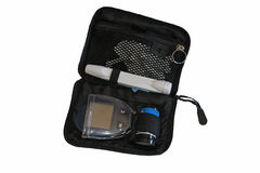 Glucose monitoring kit for diabetes. A blood glucose kit for home use with monitor, lancets, test strips, and test strip container Stock Photo