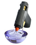 Glue gun. Dripping hot glue gun on white background Royalty Free Stock Photography