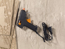 Glue gun and cardboard Royalty Free Stock Image