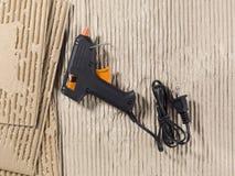 Glue gun and cardboard Royalty Free Stock Image