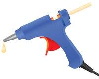 Glue gun with glue sticks Stock Photography