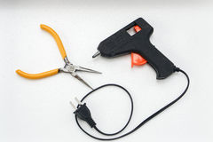 Glue gun and pliers for DIY work Royalty Free Stock Image