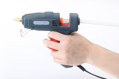 Glue pistol in hand Royalty Free Stock Photography