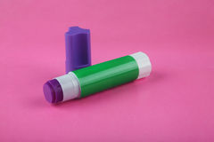 Glue Stick on Pink Royalty Free Stock Photos