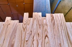 Glued furniture board from elm. Details wood production. Wood processing. Joinery work. Wooden furniture. Details wood production royalty free stock photo