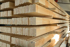 Glued timber beams. Glued pine timber beams in a production manufactory stock photos