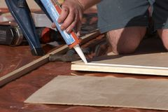 Glueing. Wood being spread with glue Stock Photo