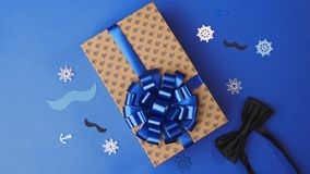 Gluing the bow to the present box for men, wrapping the present, parcel decoration, box with presents, 4k UHD. Gluing the bow to the present box for men stock footage