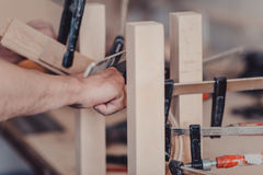 Gluing Furniture Parts With Clamps Stock Photography
