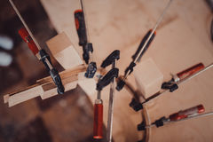Gluing Furniture Parts With Clamps Royalty Free Stock Photo