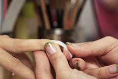 Gluing nails on finger Royalty Free Stock Photography