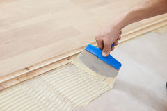 Gluing parquet floor work Stock Photography