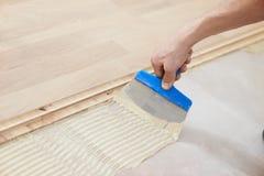Gluing parquet floor work Stock Photography