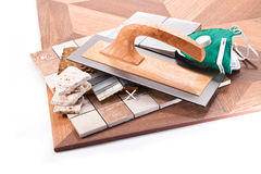 Gluing tiles on floor and walls Royalty Free Stock Image