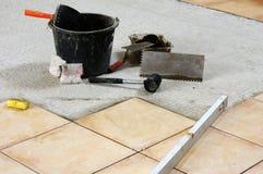 Gluing tiles Stock Image