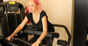 Glute machine with instructor stock photo
