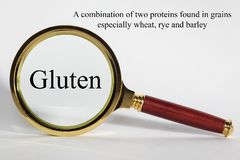 Gluten Concept and Magnifying Glass stock photo