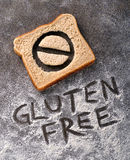 Gluten Free. Bread with symbol and caption written in flour Royalty Free Stock Photo