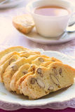 Gluten free almond biscotti with tea. In vertical format with selective focus Royalty Free Stock Photos
