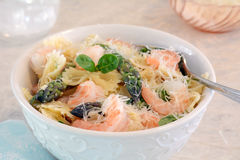 Gluten free bow tie pasta with prawns and asparagus Royalty Free Stock Images