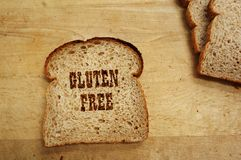 Gluten free bread. Bread slice on a cutting board with Gluten Free text Stock Image