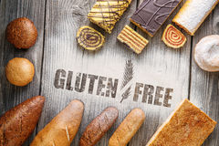Gluten free breads, pastries, christmas cake on wooden background with letters, picture for bakery or shop Royalty Free Stock Images
